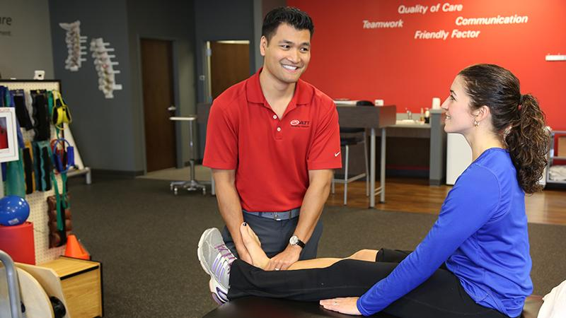 ATI therapist with a patient, examining leg