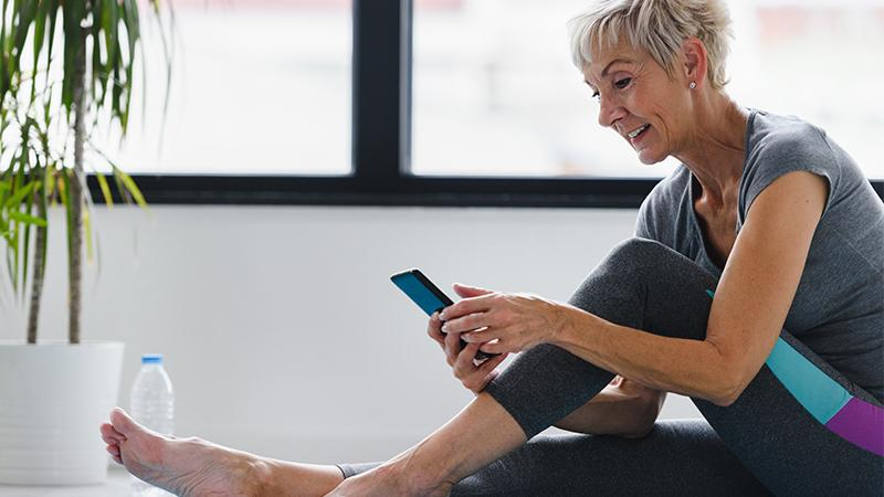 Patient looking at app while doing exercises
